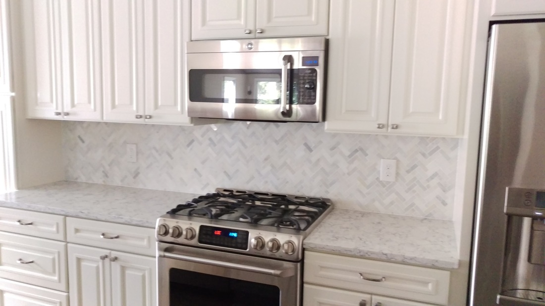 marble herringbone mosaic back-splash