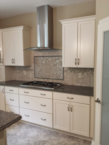 stainless hood vent with kitchen back-splash
