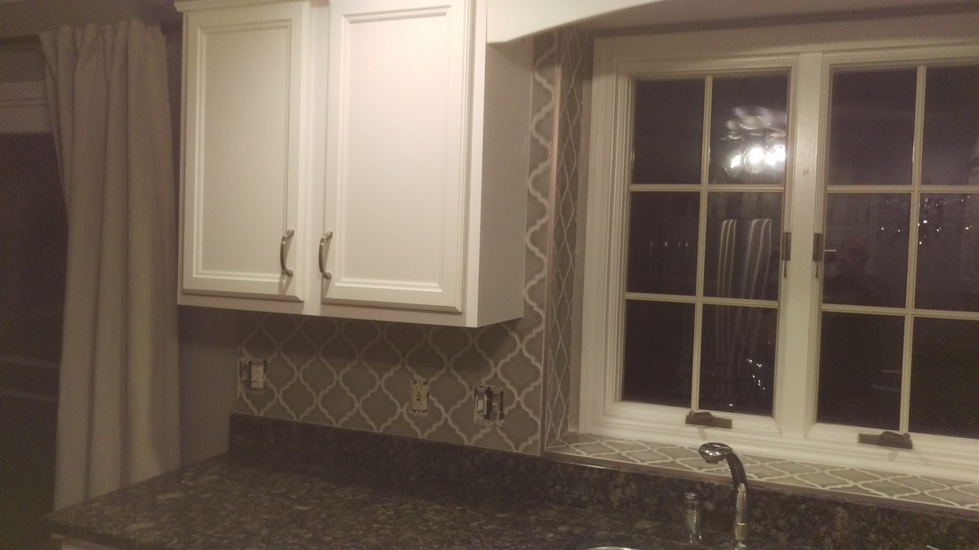 Gray arabesque tile with granite counter-tops