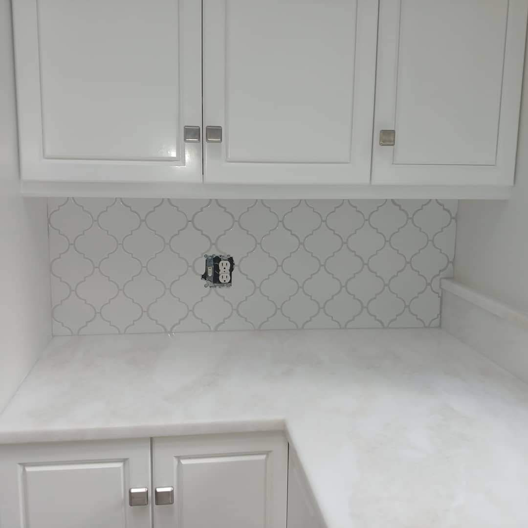 white glazed arabesque tile with white Quartzite  counters.
